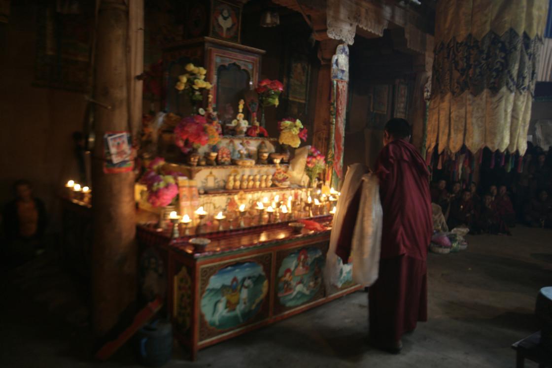 """Nun at Shrine, Dechenling, Nangchen, Tibet"" stock image"