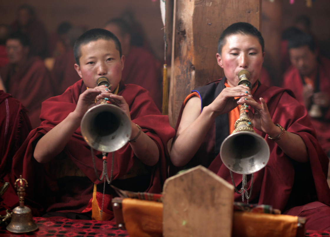 """uns blowing horns, Getchok Nunnery, Tibet"" stock image"