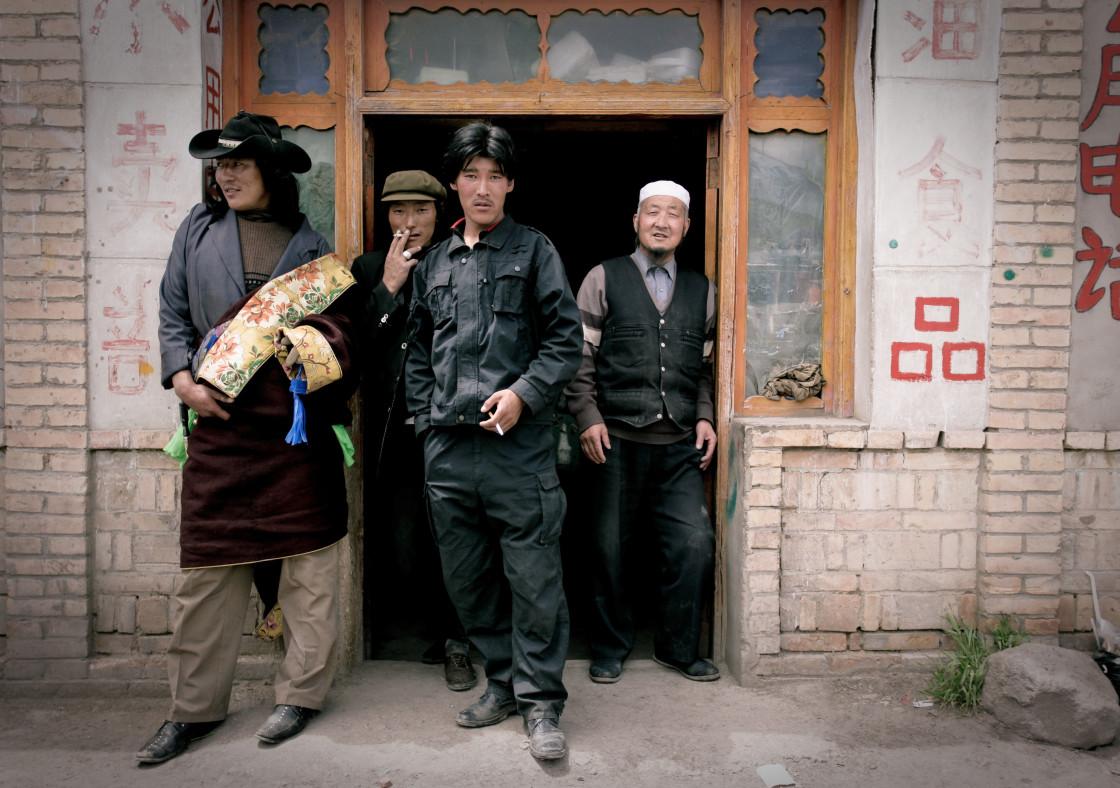 """Khampa Men outside store, Nangchen, Tibet"" stock image"