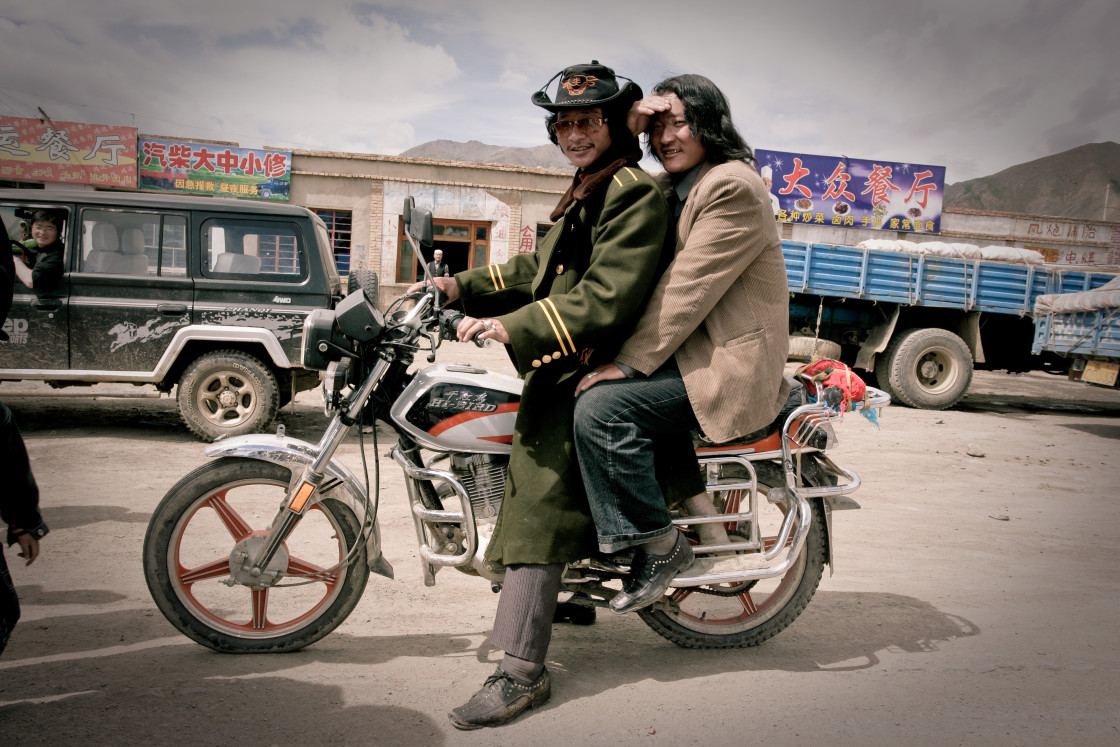 """Two khampa men on Motorcycle, Nangchen, Tibet"" stock image"