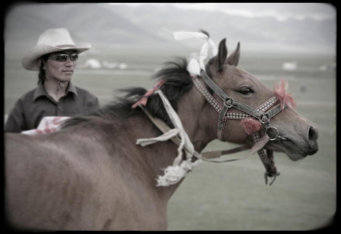 """Man with Horse, Jeykundo, Tibet"" stock image"