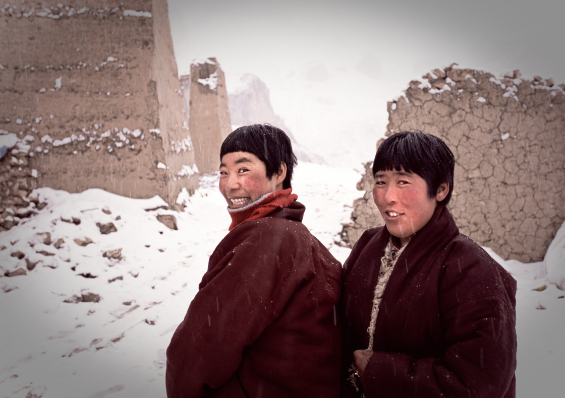 """Two nuns in snow storm, Nangchen, Tibet"" stock image"