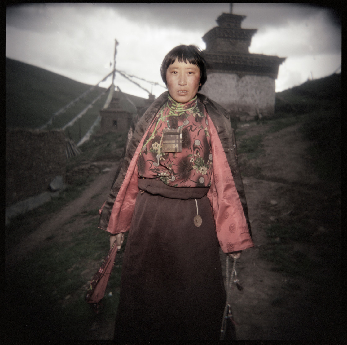 """Nun on path, twilight ,Dechen Ling Nangchen Tibet"" stock image"