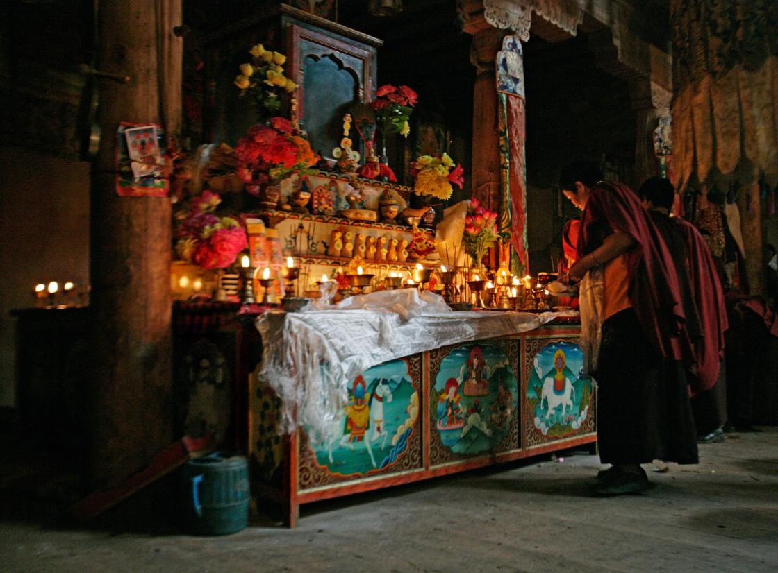"""Nun attending Shrine, Getchok Nunnery, Tibet"" stock image"