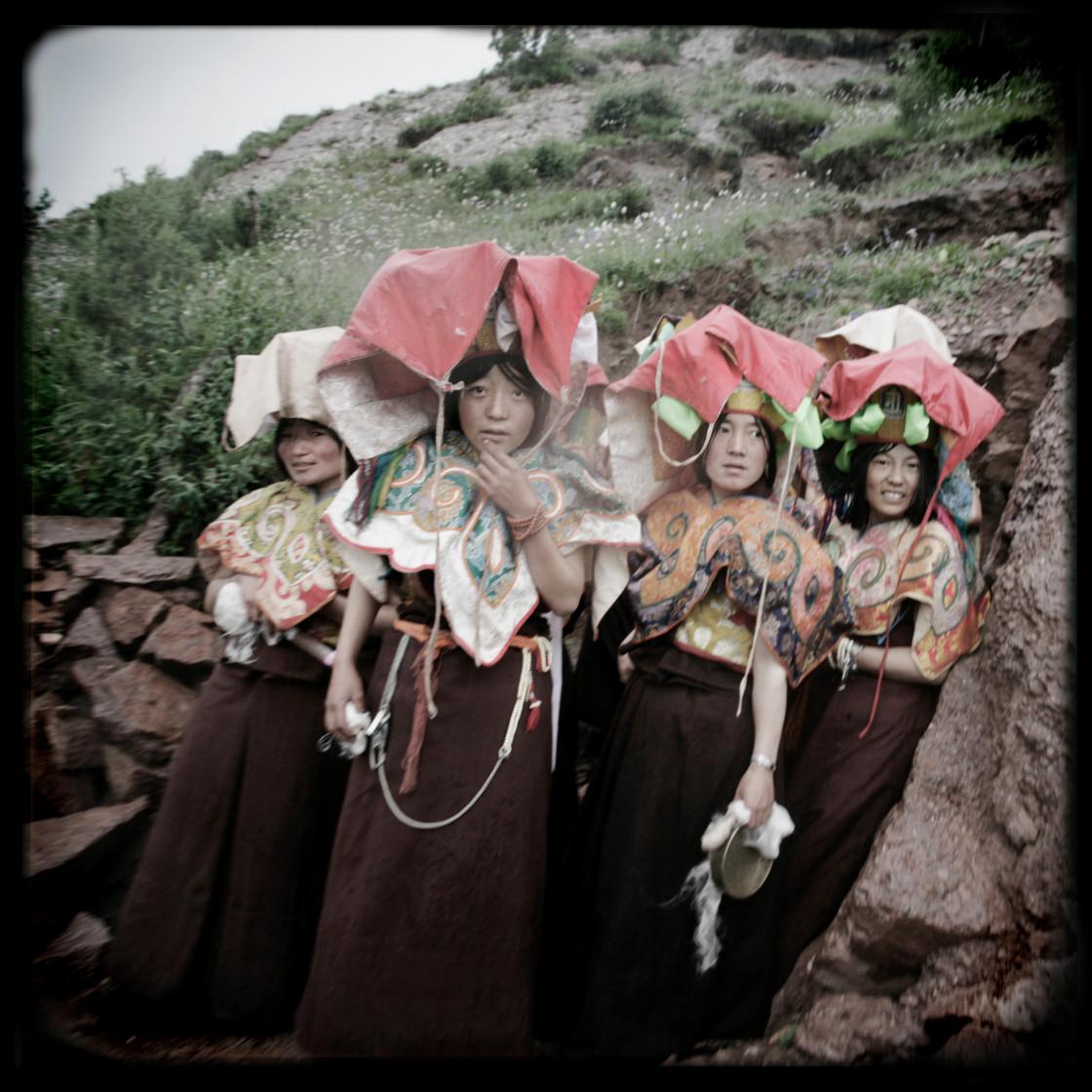 """Six year retreat nuns in ritual dress, Gechak Nunnery, Tibet"" stock image"