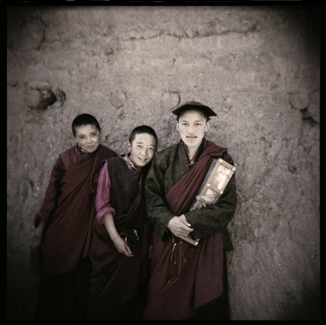 """Nuns with prayer books, Dechenling, Nangchen, Tibet"" stock image"