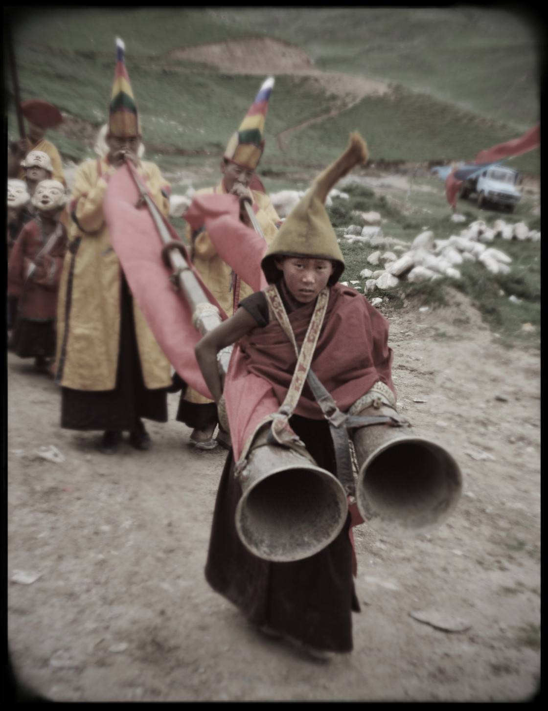 """Young monks with horns in ritual procession, Nangchen, Tibet"" stock image"