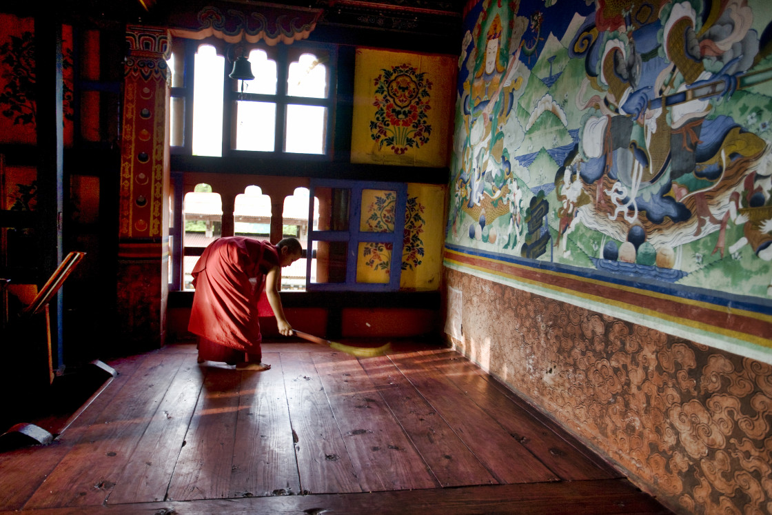 """Young monk sweeping in Monastery, BhutanYoung, Monk, sweeping, Mongar Dzong monastery, bhutan, buddhism, monastery, religion, asia, travel, buddhist, mountain, buddha, himalaya, bhutanese, temple, tourism, architecture, culture, holy, pilgrimage, building"" stock image"