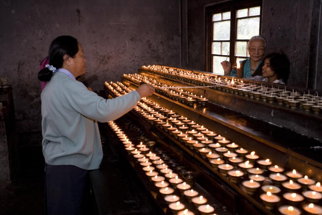 """women lighting candles, Ladakh"" stock image"