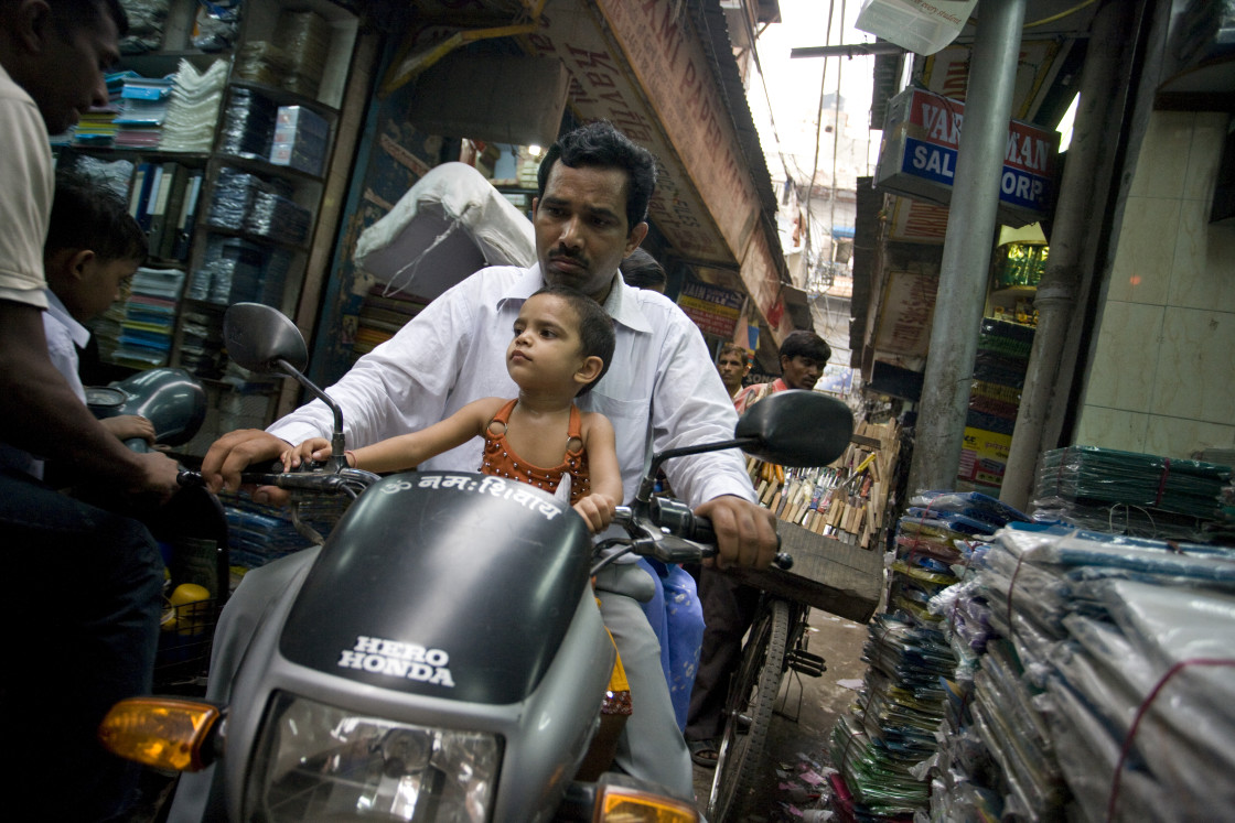 """""""Man and child on motorcyle, Old Delhi_G3T7364"""" stock image"""