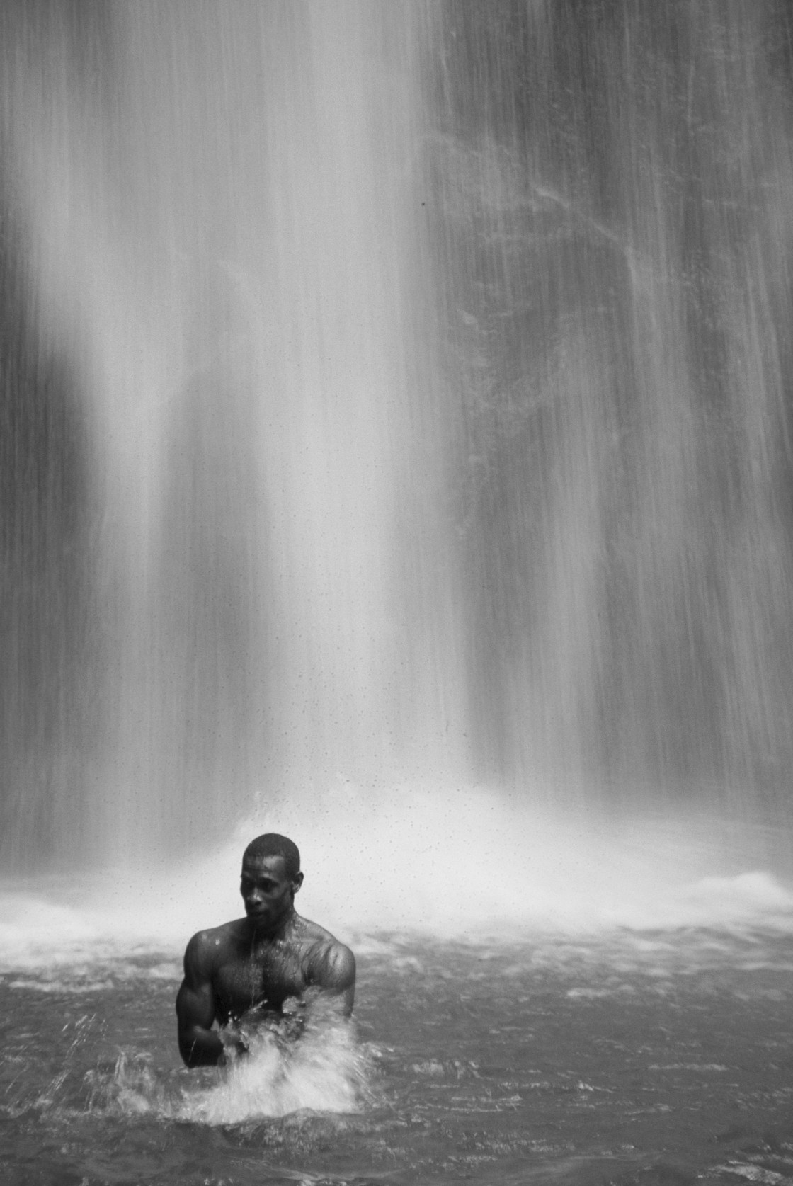 """""""Man in front of waterfall, Dominica"""" stock image"""