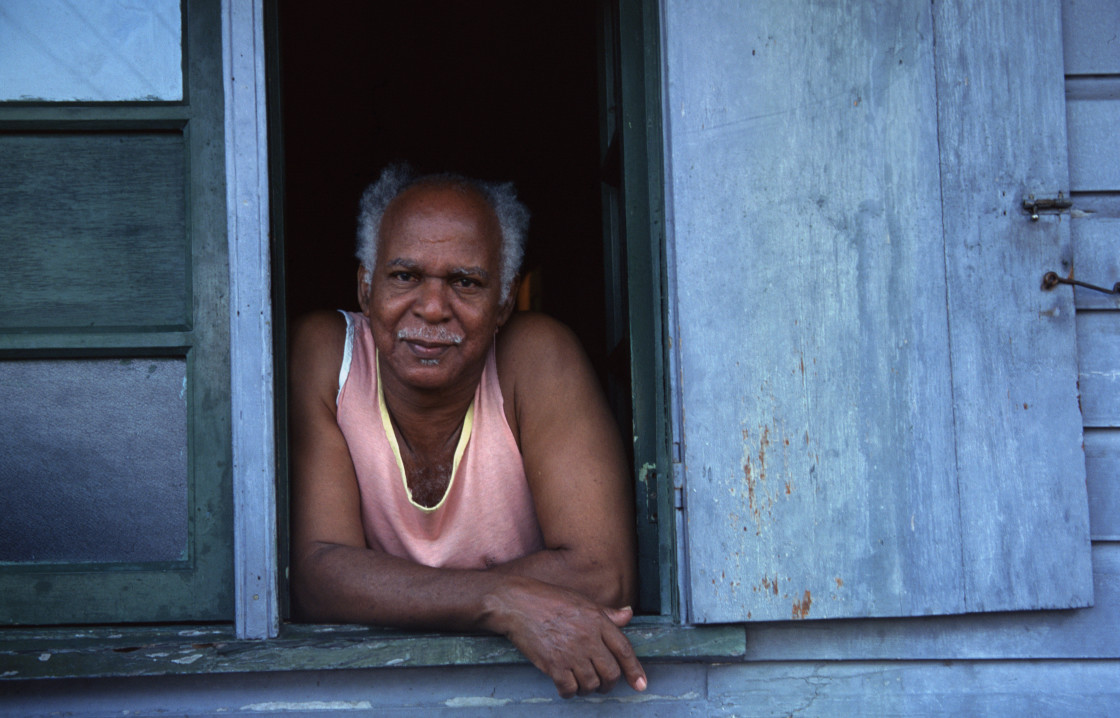 """Man in window, Dominica"" stock image"