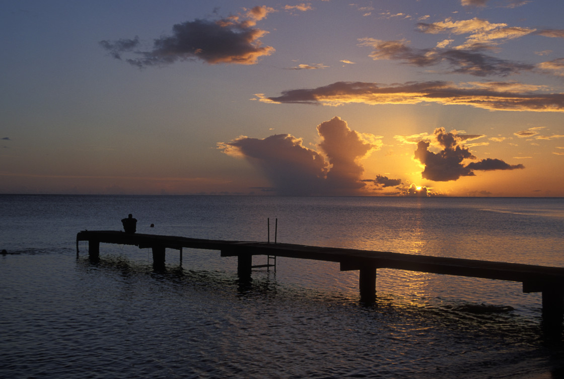 """Sitting on dock watching sunset, Dominica"" stock image"