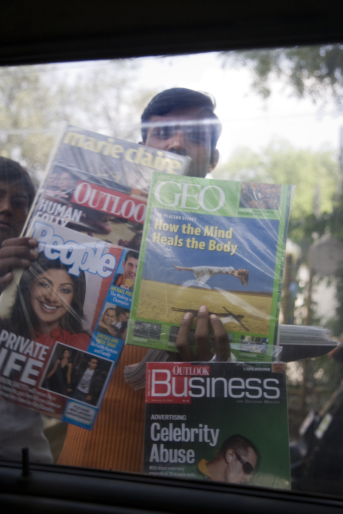 """Man selling magazines, New Delhi, India_G3T8082"" stock image"