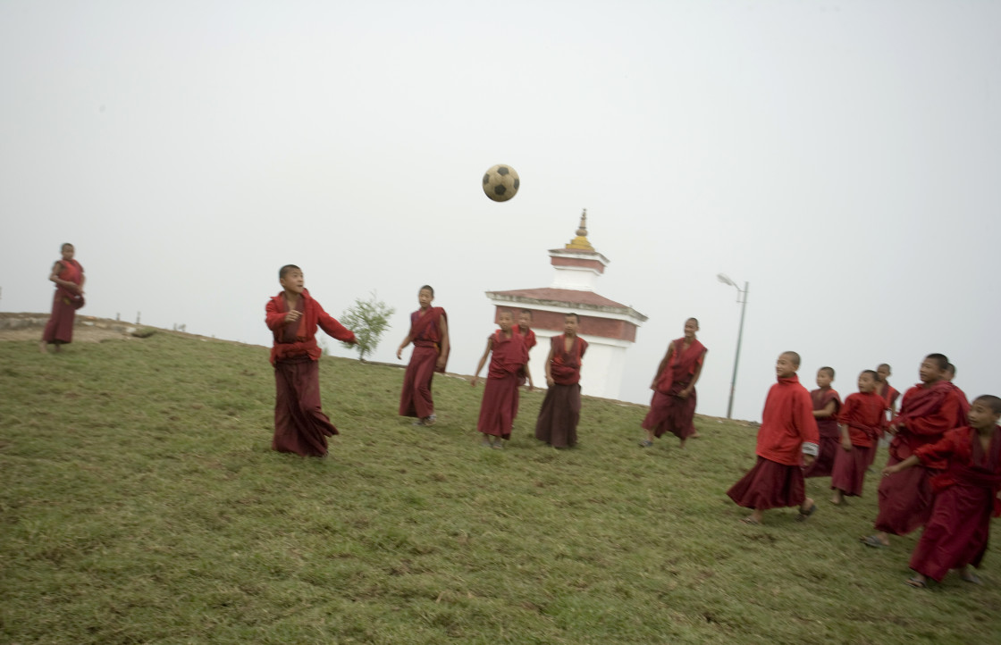 """Monks playing soccer, Bhutan"" stock image"