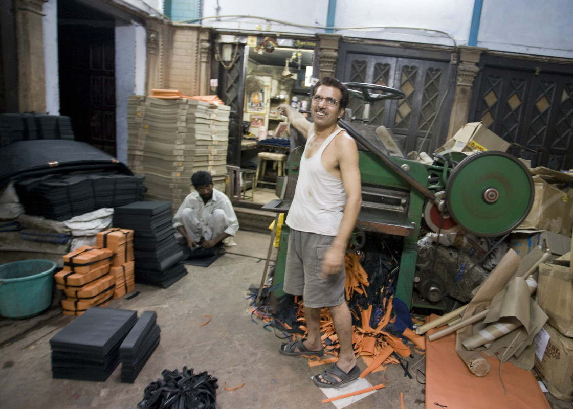 """Printer at paper cutter, Old Delhi_G3T7352"" stock image"
