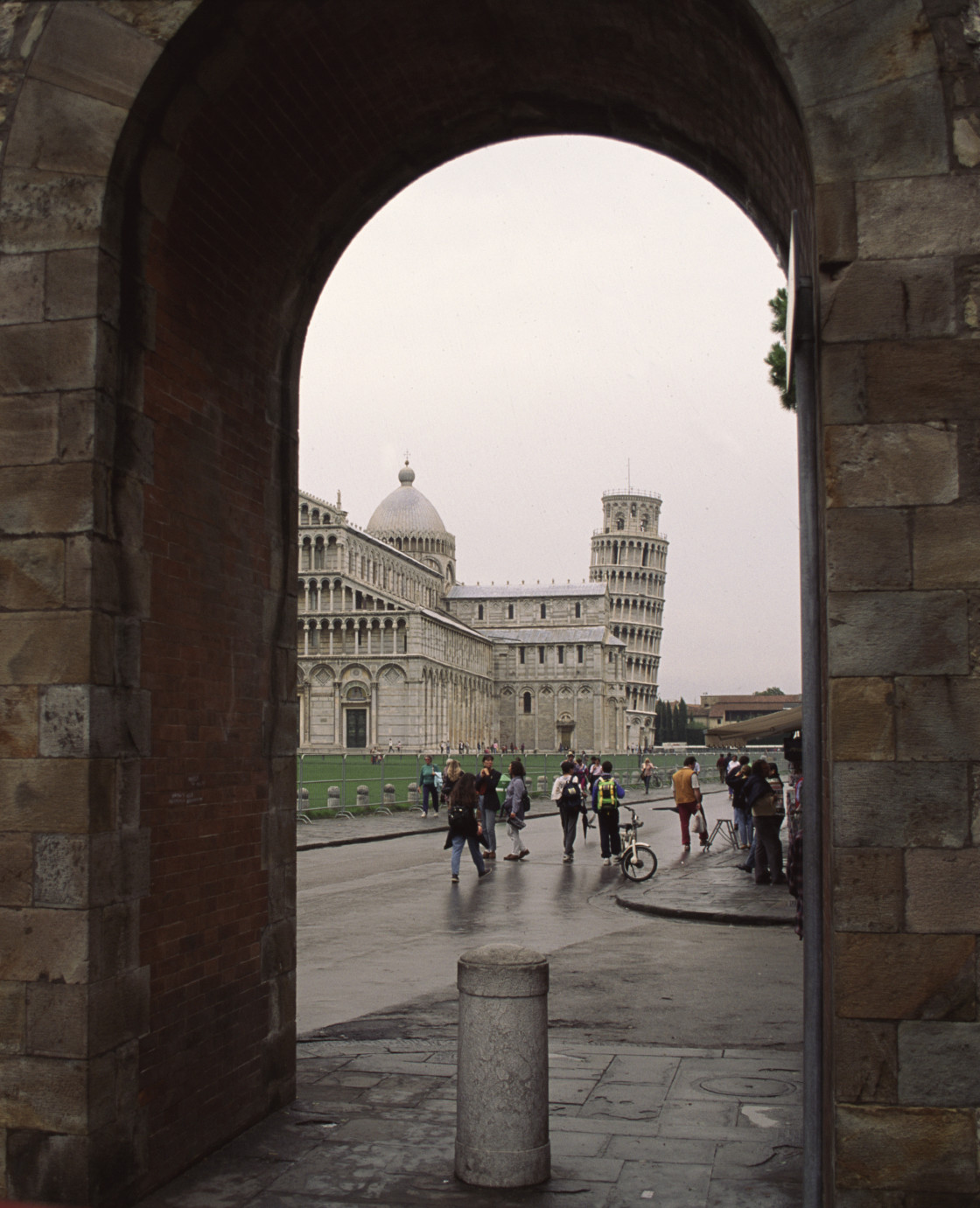 """Tower of Pisa through archway, Pisa, Italy"" stock image"