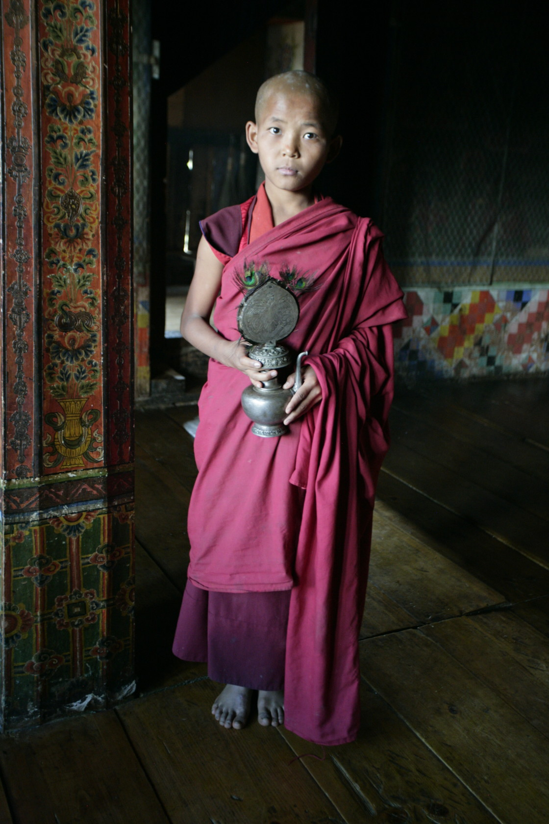 """Young monk with ritual objects, Bhutan"" stock image"