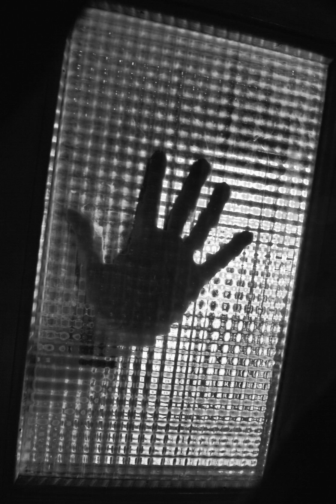 """Shadow of hand on glass"" stock image"