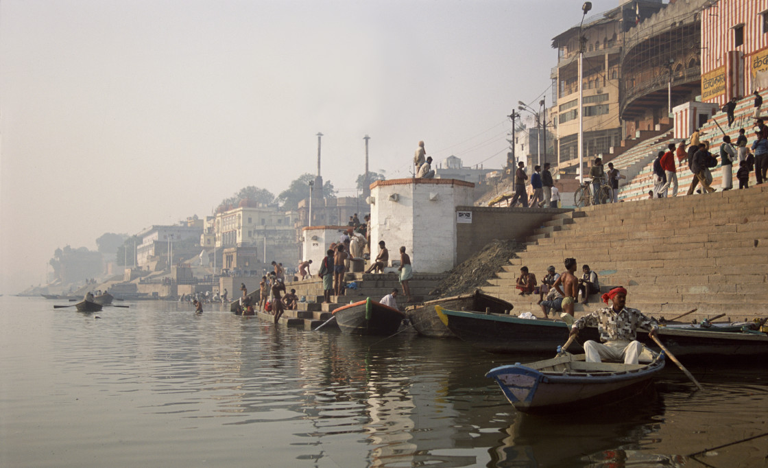 """Boats by the ghats on the Ganges, Varanasi, India"" stock image"