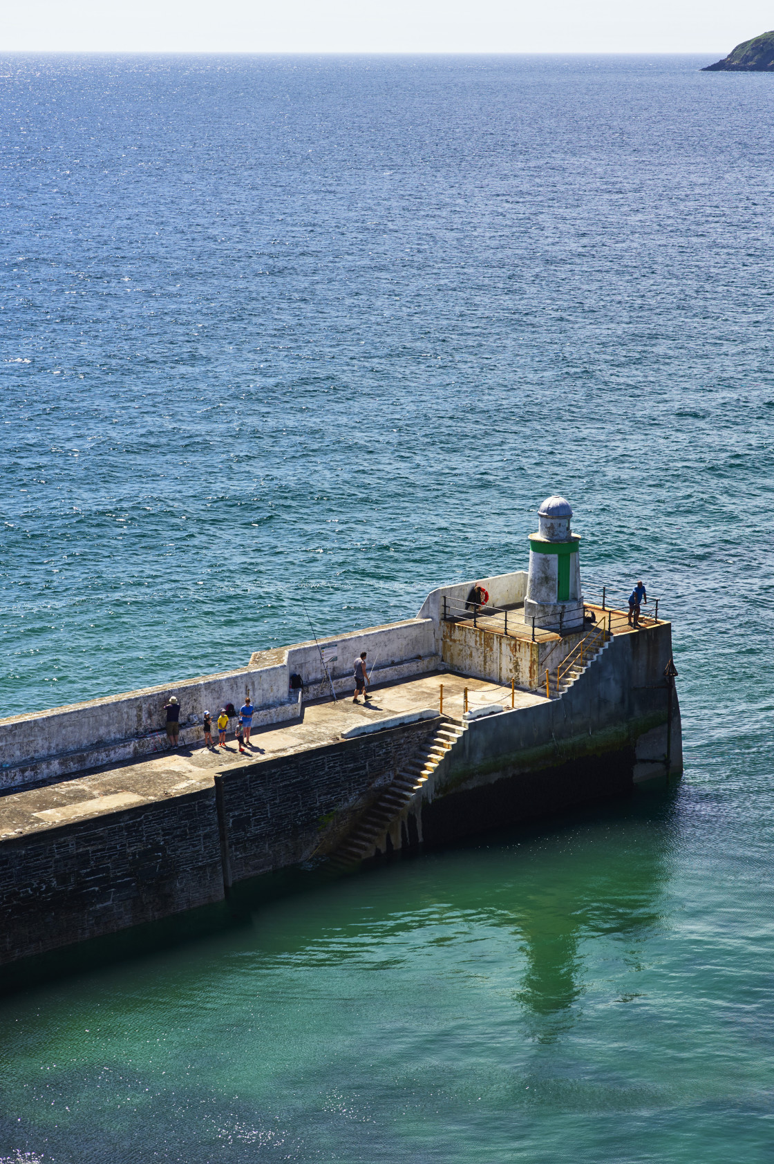 """""""People fishing at Laxey, Isle of Man"""" stock image"""