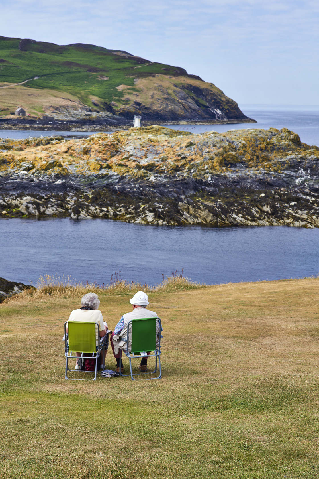 """""""Older couple sitting in perfect spot"""" stock image"""