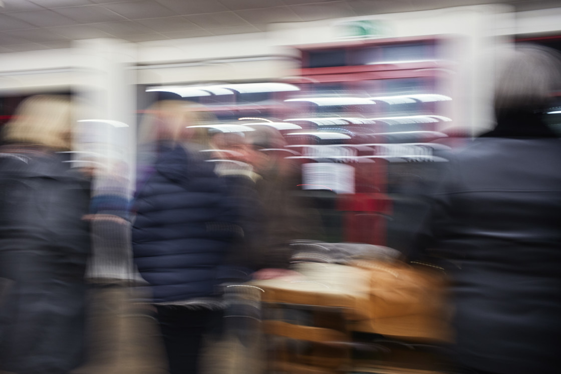 """""""Blurred people in a busy cafe"""" stock image"""