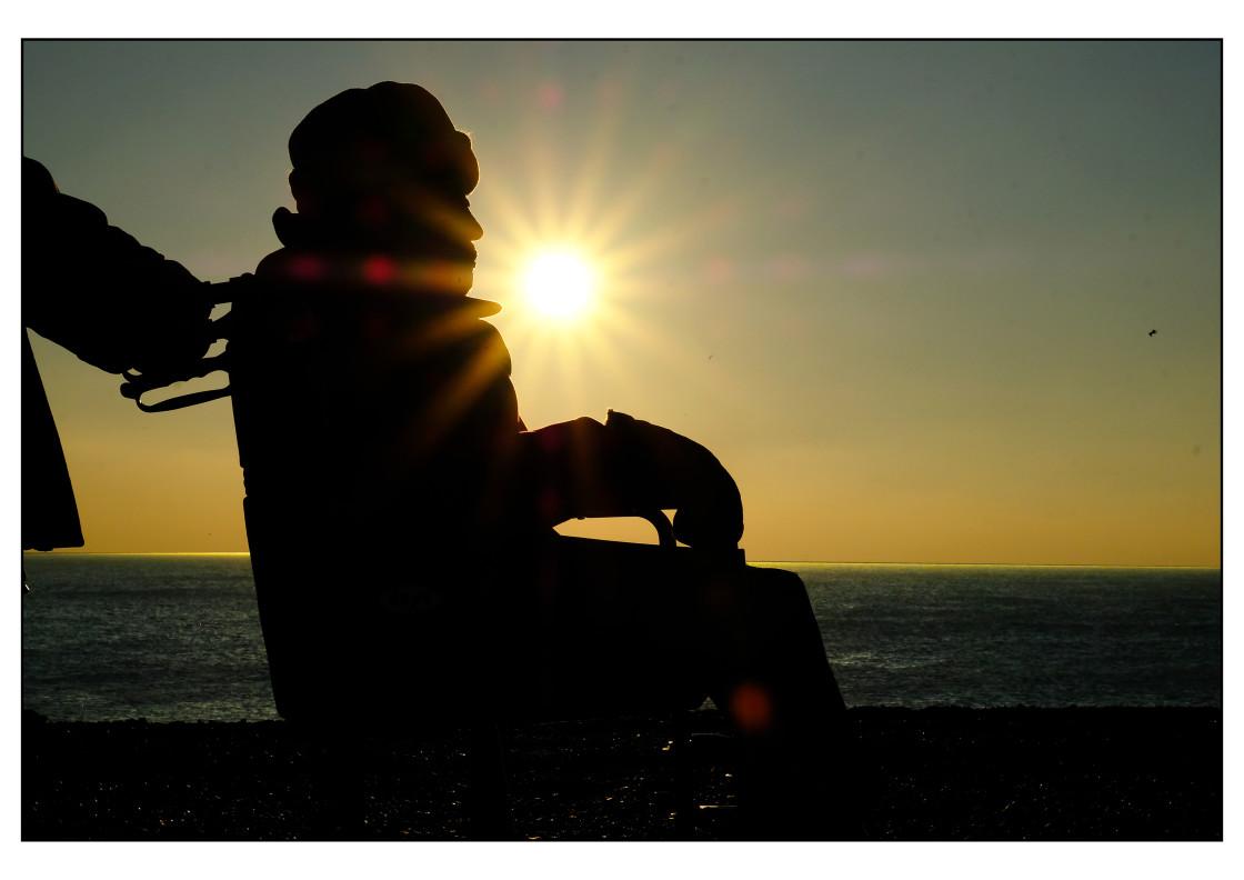 """Man in Wheelchair and Sun Burst"" stock image"