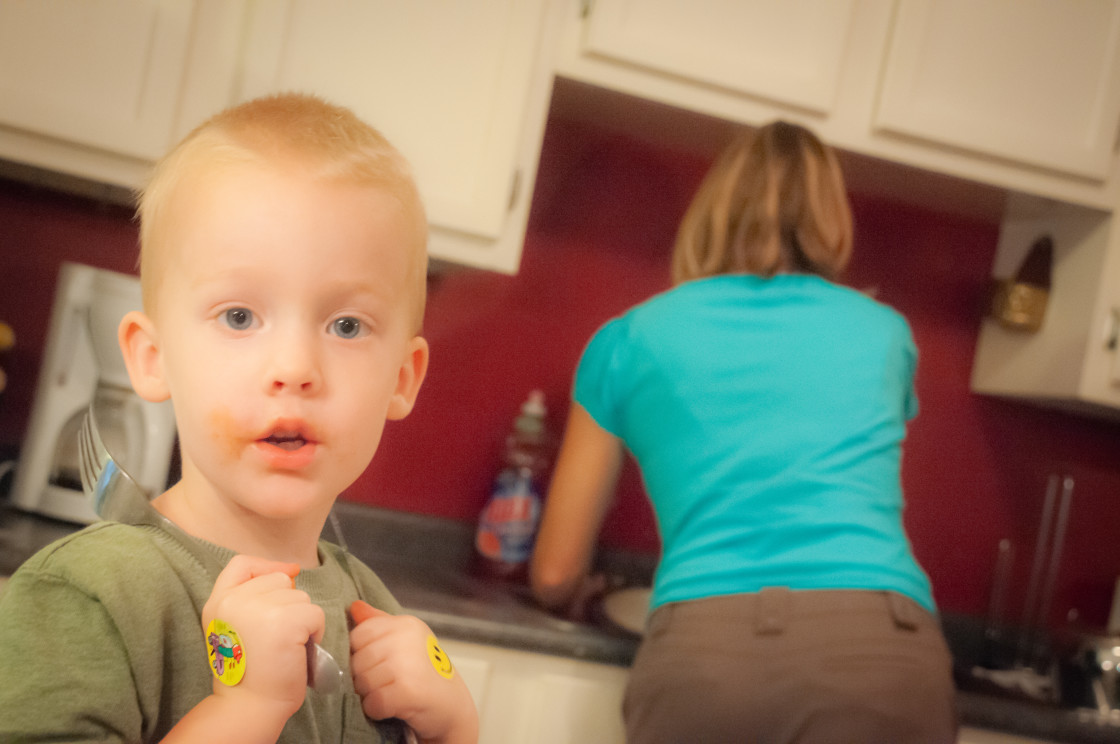 """""""Little Boy in Kitchen with Mom"""" stock image"""