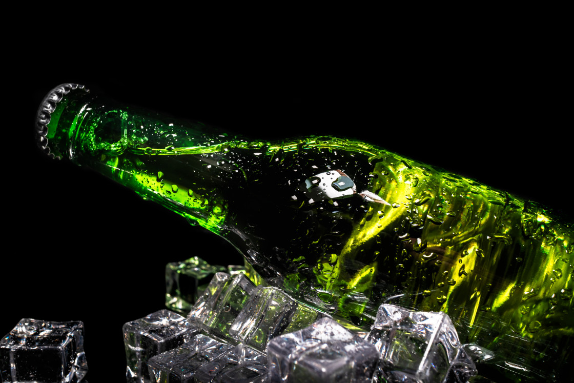 """Cold beer in a green bottle"" stock image"