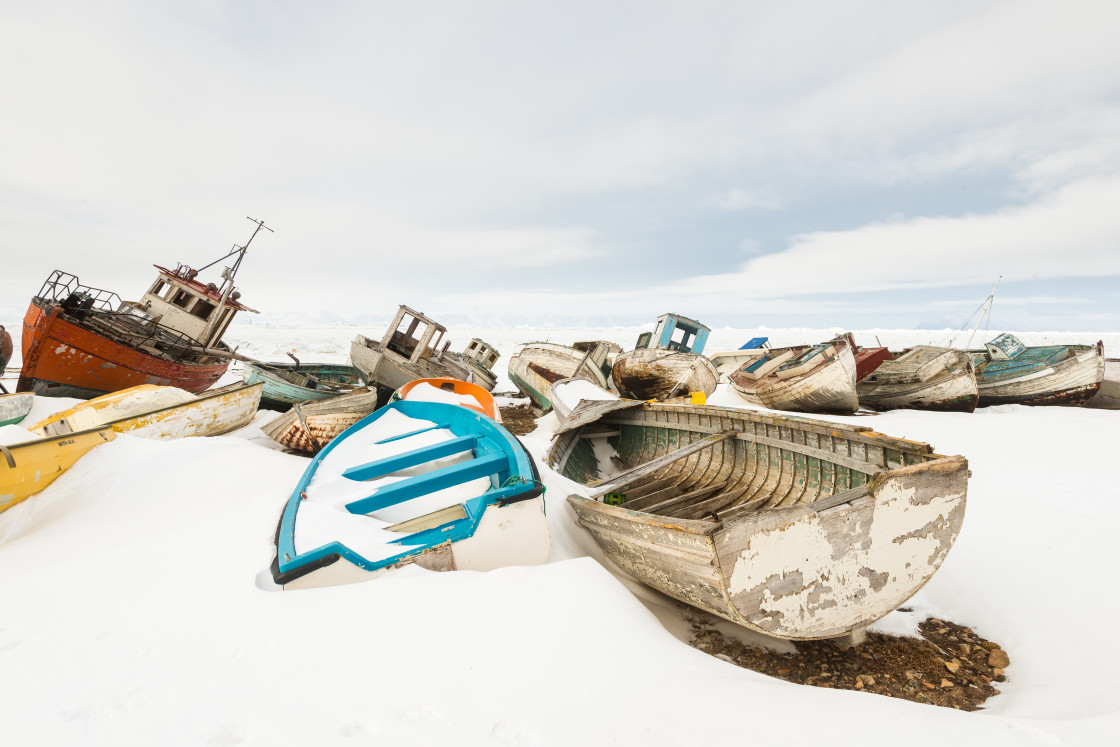 """Abandoned old boats covered with snow in winter"" stock image"