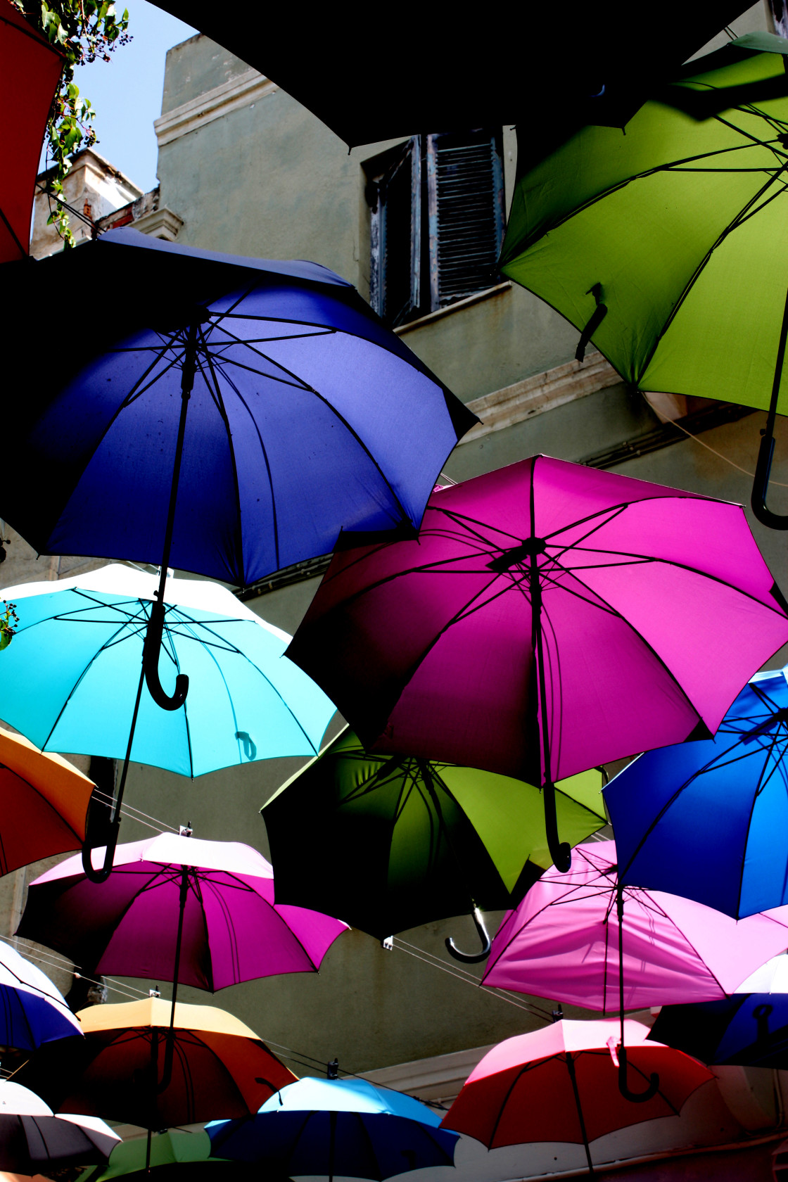"""Umbrellas on a street in Ermoupoli on Syros"" stock image"