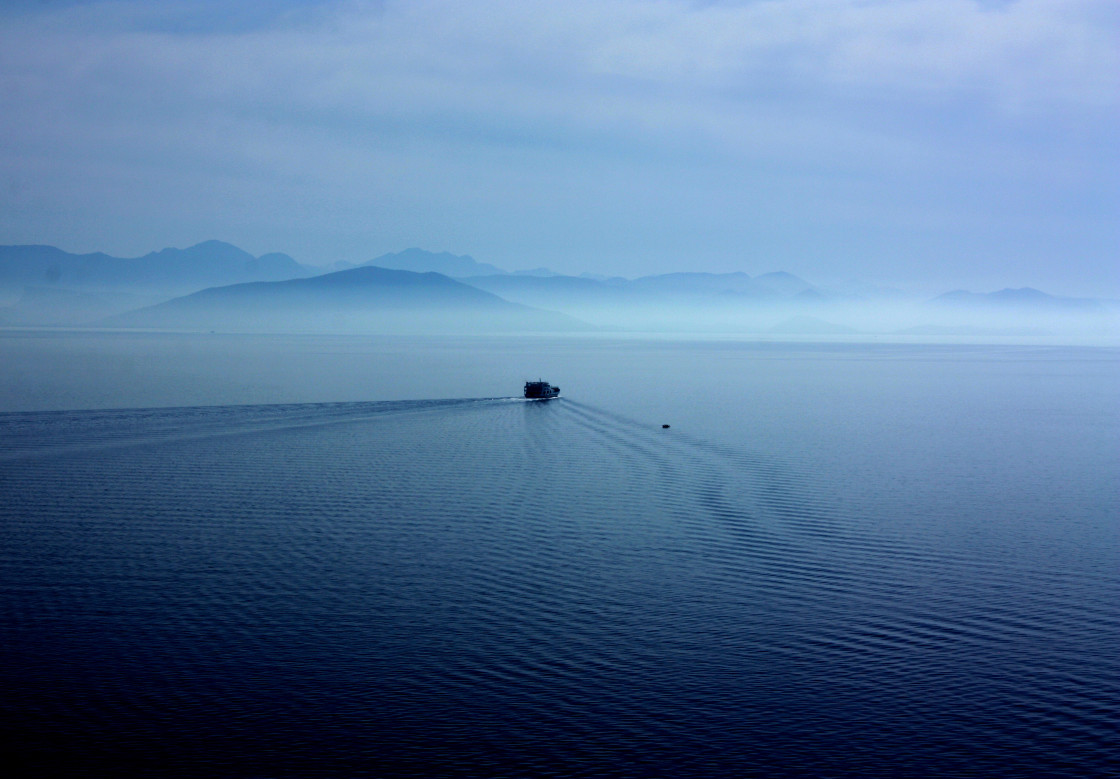 """Small ferry heading southwards away from Corfu"" stock image"