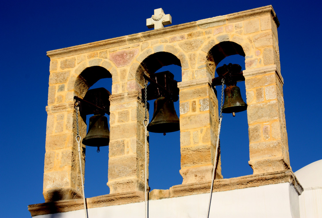 """Three bells on a church in Skala on Patmos"" stock image"