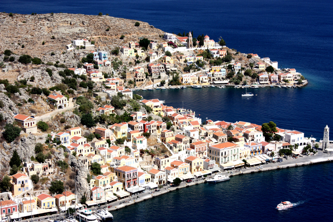 """A view of Symi Harbour from Yialos on Symi"" stock image"