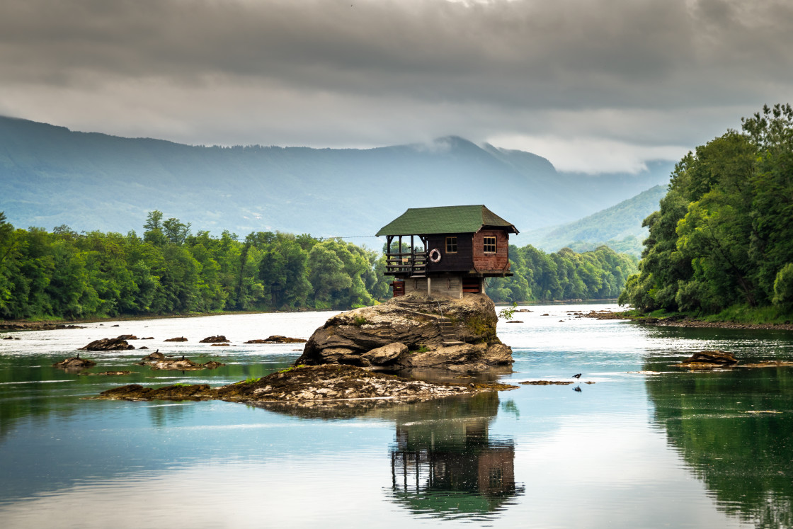 """Small house on a stone on Drina river, near the Bajina Basta in Serbia"" stock image"