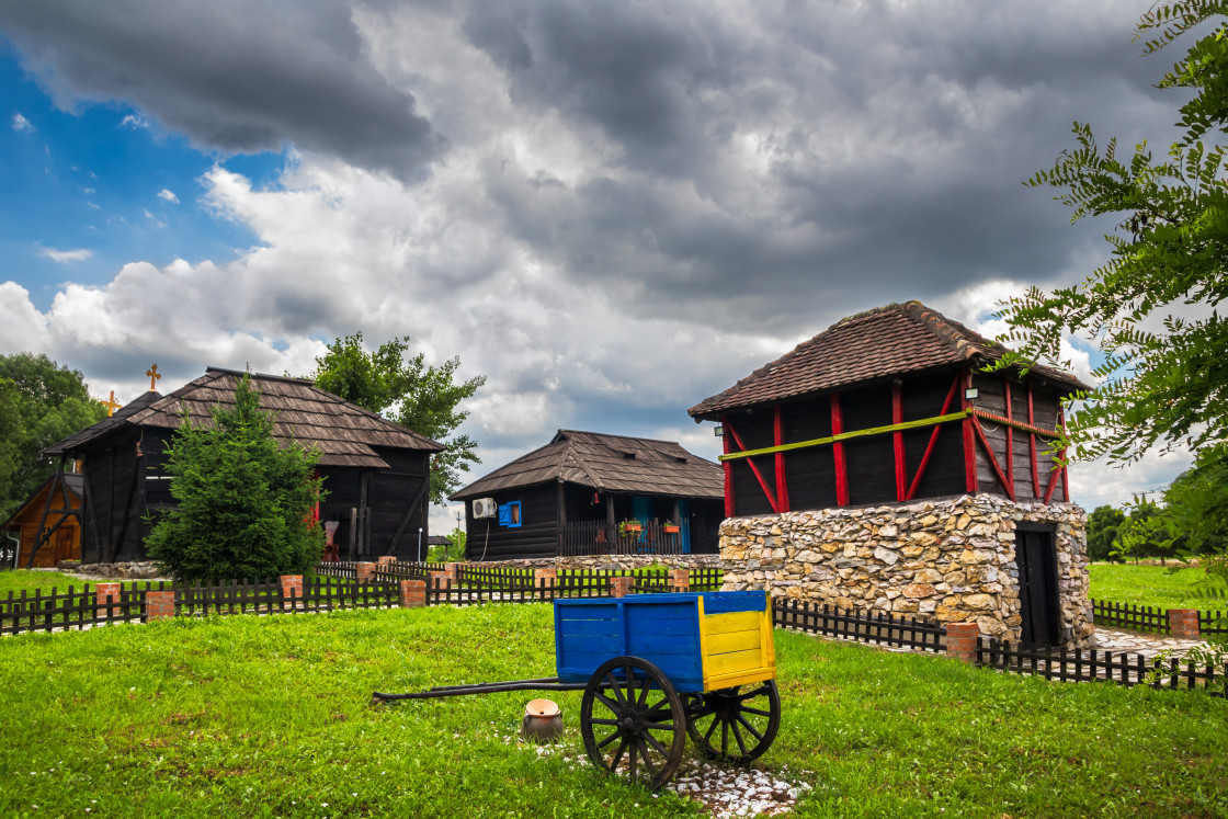 """Small wooden idyllic houses in a ethno village Moravski Konaci in Serbia"" stock image"