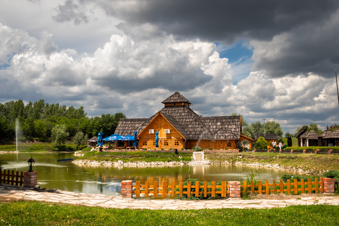 """Restaurant by the lake in a ethno village Moravski Konaci in Serbia"" stock image"