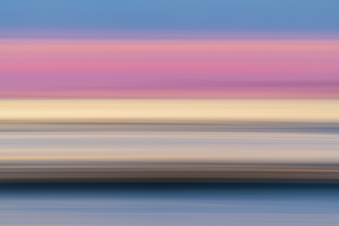 """Blurry colorful lines at coast"" stock image"