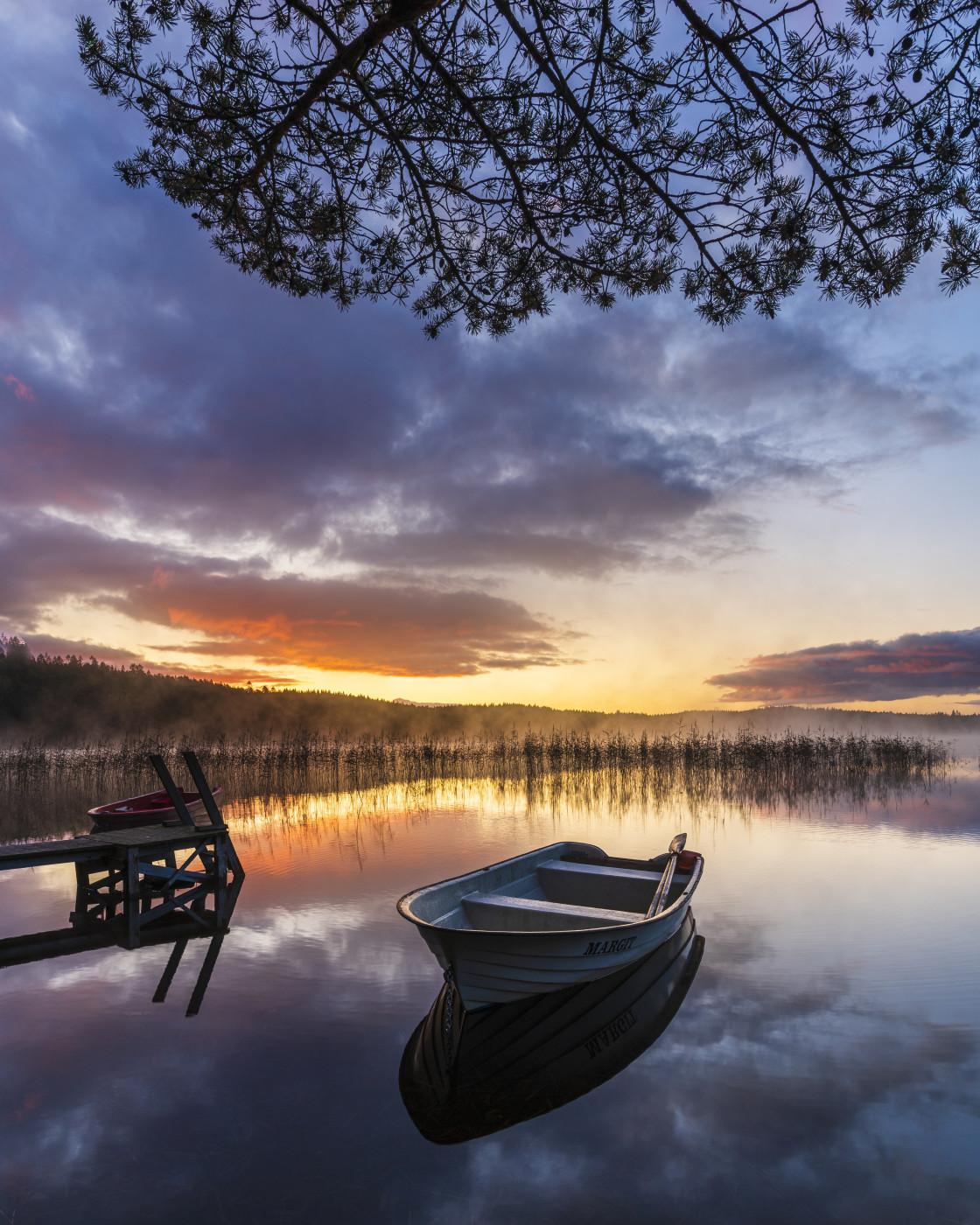 """""""Boat on calm lake at sunrise"""" stock image"""