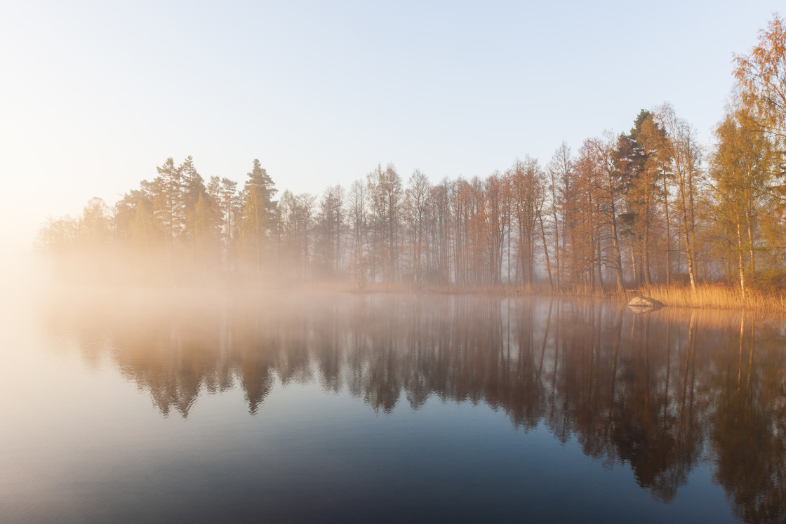"""Still and misty lake"" stock image"