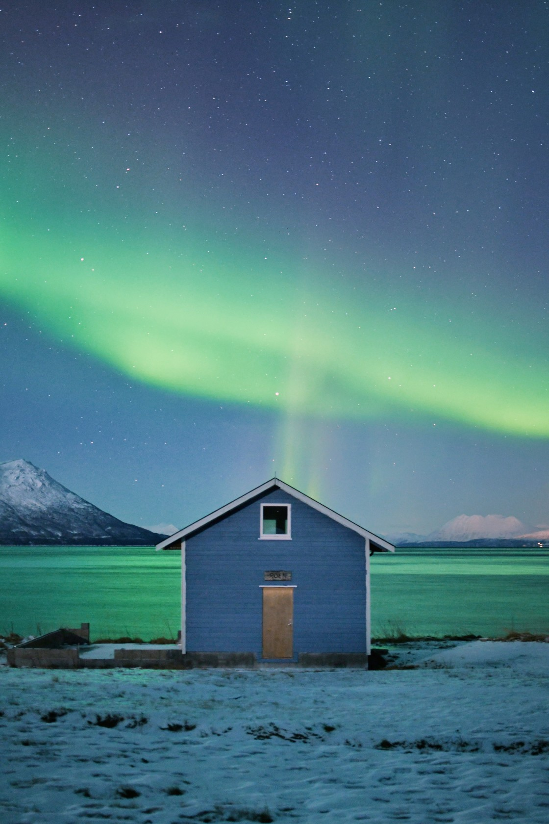 """""""Northern Lights over an Isolated Cabin in Norway"""" stock image"""