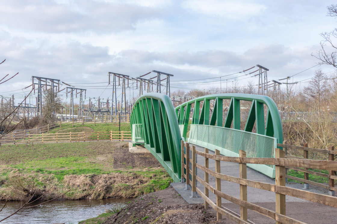 """Green bridge over the River Goyt, Woodbank Park, Stockport. UK."" stock image"