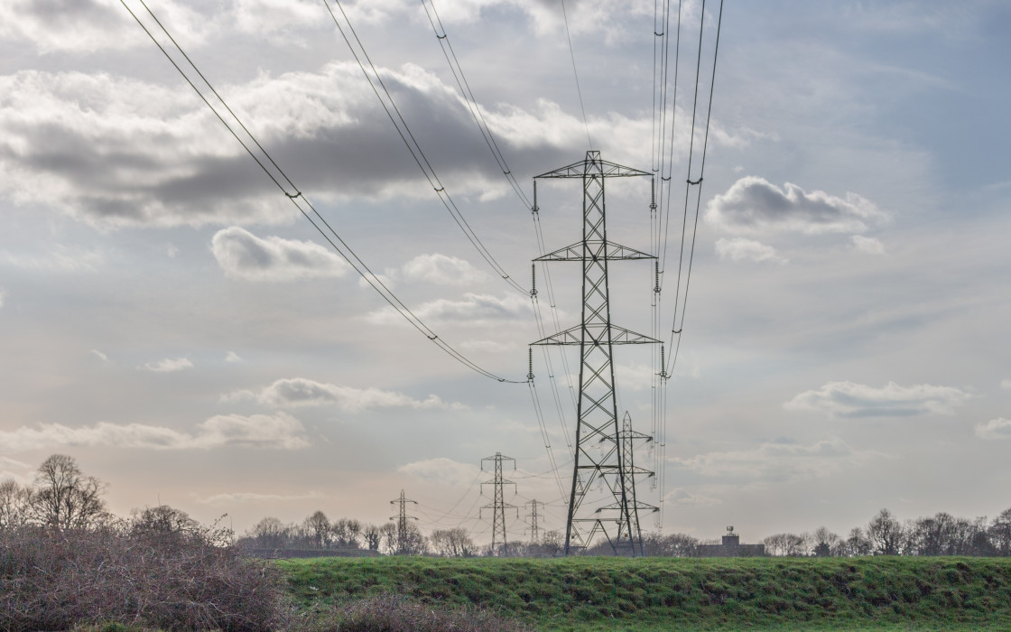 """""""Electricity pylons seen froim the River Mersey, Stockport, Cheshire, UK."""" stock image"""