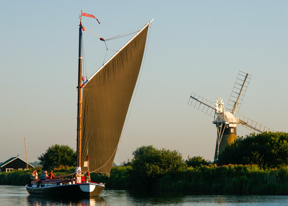 """Wherry passes St Benets Level Windmill"" stock image"