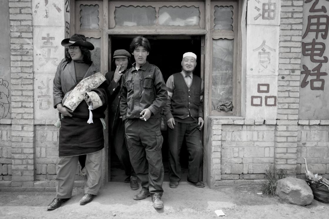 """Khampa men outside store, Kham, Tibet"" stock image"