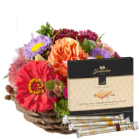 "Cute Basket of Flowers with Gottlieber Hüppen ""Special Edition for Fleurop"""