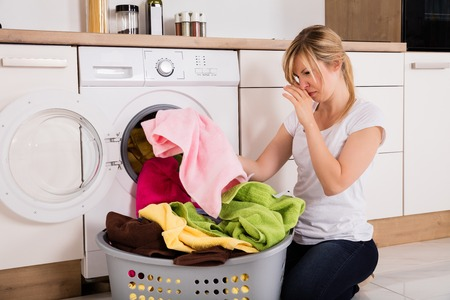 how to get that damp smell out of clothes
