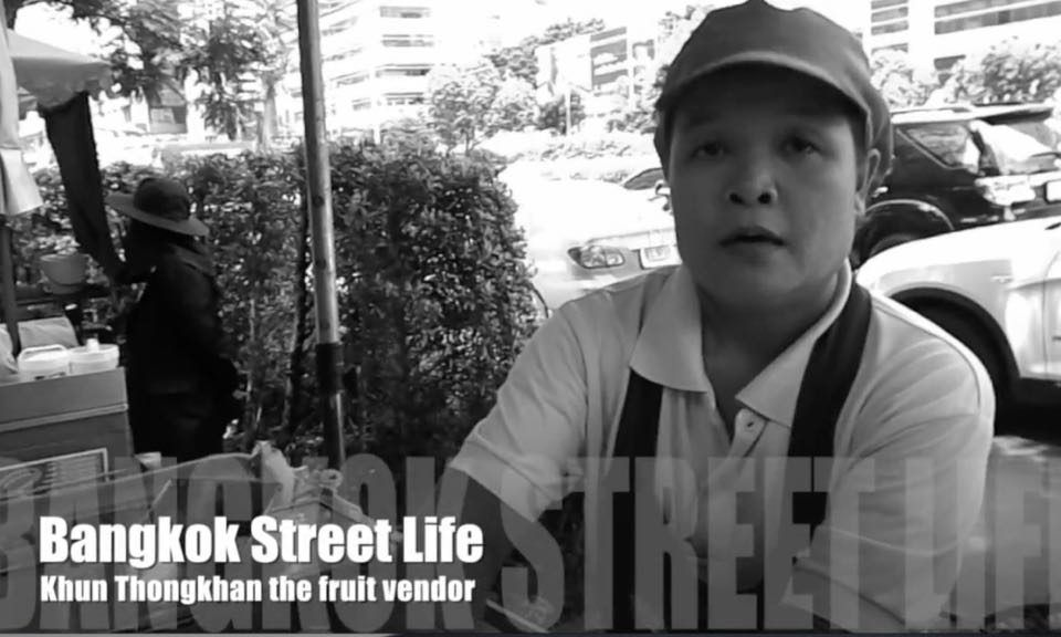 Street food vendor selling fruit in Bangkok