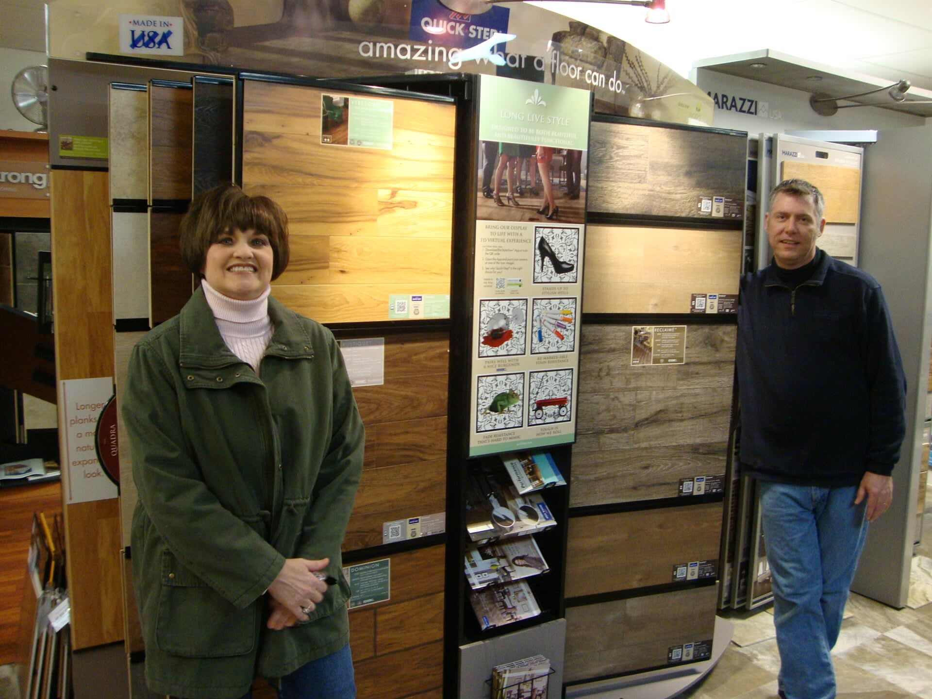 Phil Jr. and Amy showing of hard surface flooring ready for your Chesapeake, VA home